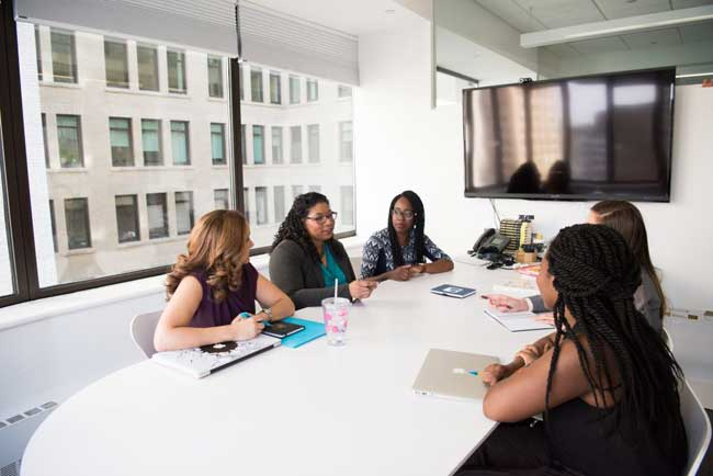 Canva-Group-of-Five-Women-Gathering-Inside-Office